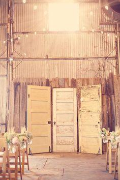 Old door backdrop for barn wedding.