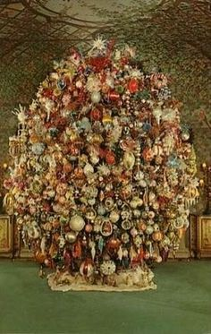 """Harold Lloyd's spectacular Christmas tree at Greenacres ` """"It started sometime around Thanksgiving. My grandparents would take me downtown to the train yards where the annual shipment of trees would arrive for the holiday season. We would pick out 3 large Douglas firs and they would be wired together to make one enormous, fantastic Christmas tree. It sat at one end of the garden room rising 20 feet in the air. It was 9 feet wide and almost 30 feet around.""""  --Suzanne Lloyd"""