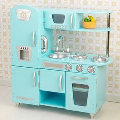 This Vintage Kitchen in Blue lets kids pretend they are cooking big feasts for the whole family. With its close attention to detail and interactive features, this adorable kitchen would make a great gift for any of the young chefs in your life.