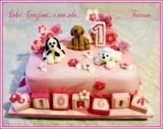 Torta decorata compleanno bimba Per il primo compleanno della piccola Giorgia, una torta tutta rosa e fucsia, decorata con tre cagnolini, fiori trapuntati..