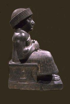 Seated statue of Gudea, prince of Lagash/Tello, ancient Girsu  Neo-Sumerian period (c. 2125-2110 BC)  Diorite    After the fall of the empire of Agade, Gudea, prince of Lagash, inaugurated a renaissance of Sumer, marked both by literary blossoming, corresponding to Sumerian classicism,