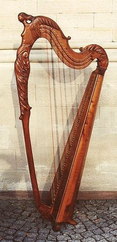 Carved triple harp