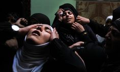 WOMEN MOURN: Relatives of alleged militant Mohammed Daher, who was killed in an Israeli airstrike, mourned at his funeral in Gaza City Tuesday. Airstrikes and rocket fire ebbed as an Egypt-brokered cease-fire took hold, ending days of cross-border violence that killed at least 24 Palestinians. (Mahmud Hams/Agence France-Presse/Getty Images)