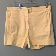 Nike pale yellow gold shorts - worn once! Nike pale yellow gold shorts - worn once! Zippered pockets Nike Shorts