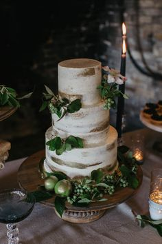 Nearly naked gold brushed wedding cake | Image by Luke and Mallory