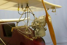 Pilot seat, wind screen, engine and airspeed indicator