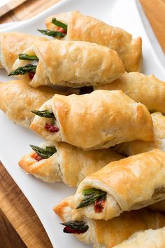 Ingredients: Serves: Makes 24 puffs  2 puff pastry sheets (1 box), thawed 24 extra-thin asparagus spears (tough, stalky bottoms trimmed off), cut in half 6 slices