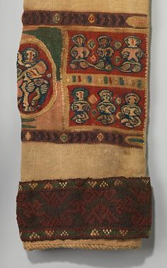 Object Name:      Tunic  Date:      660–870 AD  Geography:      Egypt, Eshmunein  Medium:      Tapestry weave in polychrome and undyed wool on plain-weave ground of undyed wool; applied borders with pattern and brocading weft in polychrome wool and undyed linen   Dimensions:      Textile (including sleeves): H. 79 1/8 in. (201 cm) W. 46 7/8 in. (119.1 cm)  Classification:      Textiles-Costumes  Credit Line:      Gift of Maurice Nahman, 1912  Accession Number:      12.185.2