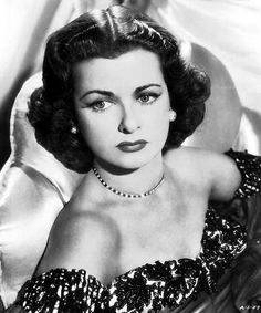 Joan Bennett... 1930's actress born in 1910 who made more than 70 motion pictures from silent movies to the sound era.  She had three distinct phases to her career.  Her early career started as a winsome blonde, followed later by a sexy brunette and ending with a warmhearted wife/motherly type.