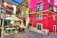 Beautiful wide angle image of the tight streets with lots of colors in Lisbon, Portugal. HDR Copyright Dennis van de Water