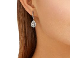 A stunning new addition to Swarovski's bestselling Attract family. This pair of pierced earrings features a halo of clear crystal pavé around a... Shop now