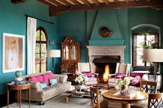 amazing-spanish-style-living-room-with-turquoise-wall-color-paint-and-classic-fireplace-and-white-granite-mantel-and-cream-tufted-sofa-and-glass-coffee-table-and-round-wood-side-table-1024x682.jpg (1024×682)