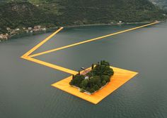 Christo's golden Floating Piers stretch across an Italian lake