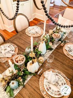 Thanksgiving tablescape full of greens, pumpkins, berries and candlelight! #tablescape #falltablescape #thanksgivingtablescape #falldecor #falltable #pumpkins