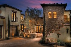 I like the exterior of this house, the mix of stone and stucco and the different elevations.