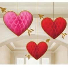 This three pack of honeycomb hearts will be ideal for spreading the love at your Valentine's day celebrations or for adding an extra special and pretty dimension to themed parties, Weddings and events too! Each heart features a honeycomb design with a golden glitter embellished border and Cupid's arrow through the centre of each. The three pack contains two red and one pink heart decoration. Each is attached to a string for ease of display.