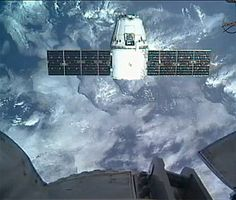 The SpaceX Dragon capsule has successfully docked with the International Space Station.