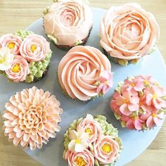 Absolutely beautiful floral cupcakes by @achara_phoom ! Too pretty to eat! #sweettreats #sweets ...