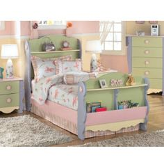 """•Perfect for a bookworm; I would have loved this bed when I was a child! With places in both the headboard and footboard to store books, magazine and whatever- this is a fairytale bed! At just $399 for a twin bed, it's also a dream come true. Check out the entire """"Dollhouse Collection"""" at Art Van Furniture's Clearance Center!"""