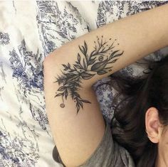 Inner arm floral tattoo