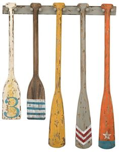 Oar Wall Decor: http://www.completely-coastal.com/2016/03/decorative-oars.html