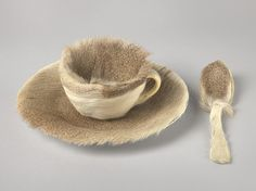 """This Surrealist object was inspired by a conversation between Oppenheim and artists Pablo Picasso and Dora Maar at a Paris cafe. Admiring Oppenheim's fur-covered bracelet, Picasso remarked that one could cover anything with fur, to which she replied, """"Even this cup and saucer."""" Soon after, when asked by André Breton, Surrealism's leader, to participate in the first Surrealist exhibition dedicated to objects, Oppenheim bought a teacup, saucer, and spoon at a department store and covered them…"""