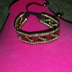 Hand beaded bracelet cold black Never worn,  adjustable, adorable! Urban Outfitters Jewelry Bracelets