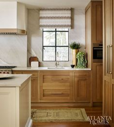 Love the stain grade cabinetry paired with the paint grade island! Via Atlanta Homes Mag: Freshly Focused, Feb 2017