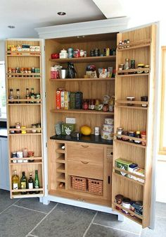 Freestanding pantry cabinet - I like the storage on the doors and the little countertop for prep.