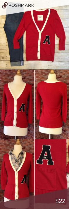 "Abercrombie & Fitch red varsity cardigan Classic cardigan from Abercrombie & Fitch. Red with cream trim and large black letter 'A'. 3/4 sleeves. Vneck with buttons. Two front pockets. 24""L. 16"" bust laying flat and buttoned. In excellent condition. 60/35/5 cotton, nylon, rabbit hair. Super soft! Size XS. *Plaid top and denim shown are also for sale in my closet, buy the look and save! Abercrombie & Fitch Sweaters Cardigans"
