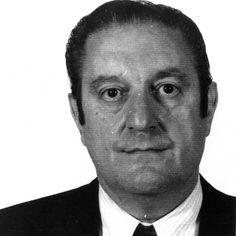 """Paul Castellano was born June 26, 1915 in Brooklyn, New York. """"Big Paulie"""" left school in the 8th grade to work at his father's butcher shop and run numbers. Castellano earned a reputation for never talking about his associations, even at the cost serving time. He was gunned down in a move by John Gotti's men to usurp power on December 16, 1985."""