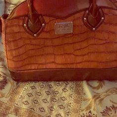 Coach purse Brown and goldish coach handbag. One flaw as shown. Perfect condition other wise. Not authentic but beautiful and well taken care of. Coach Bags Shoulder Bags