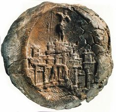 The minoan object called '' The Master's Seal'' depicts a multistore building complex above the hill of Kasteli and a figure of a young man, perhaps a worshiper. Chania of Crete - 1600 BC