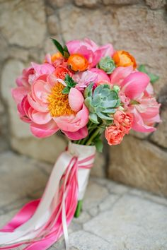 Beautiful streamer bouquet featuring shades of pink, coral, and orange. It's a perfect bright colored floral combination!
