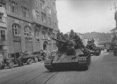 A group of Soviet tanks T-34-85 follows the street of the Lviv city