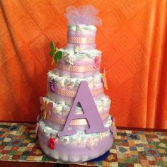 Awesome diaper cake purple pink and mint green