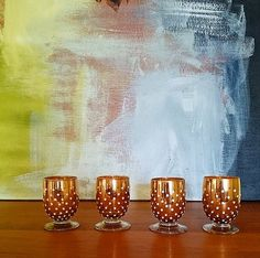 Hand Blown Gold Polka Dot Liqueur Glasses by MindenShop on Etsy. Great for glam holiday parties.