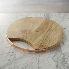 Shop Round Wooden Cheese Board. Warm, beautiful copper fashions a sleek handle that skims the rim of gorgeously grained mango wood board. Makes a fantastic presentation of drinks or appetizers, especially when paired with matching tray and cheese knives.