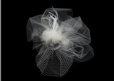 Silk flower and tulle cage veil