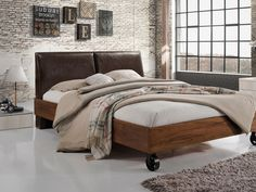 With castors and sleek lines, this industrial-style platform bed features warm acacia wood frame and distressed faux-leather upholstery Bed Springs, Mattress Springs, Interior Desing, Rustic Industrial, Platform Bed, Minimalism, Upholstery, Bedroom Decor, House Design
