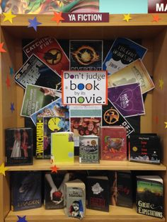 """""""Don't judge a book by its movie"""" display... all our copies of the Hunger Games series were checked out in a flash! Nov/Dec 2013."""