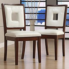 @Overstock.com - Dijon White Faux Leather Side Chairs (Set of 2) - Breathe new life into your dining area with these contemporary faux-leather side chairs. This set of two chairs is outfitted with white upholstery and features a solid Asian rubberwood frame for long-lasting good looks and durability.  http://www.overstock.com/Home-Garden/Dijon-White-Faux-Leather-Side-Chairs-Set-of-2/5230562/product.html?CID=214117 $181.99