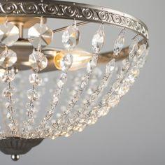Plafón JEWEL acero Este producto con nombre de joya tiene un diseño distintivo y muy original. Esta lámpara funciona con 3 bombillas de E14. Las de tipo vela le dan el toque retro que está buscando para su hogar.