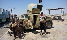 Militants outside oil refinery in Baiji, Iraq
