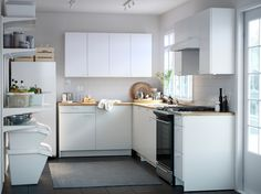 The small, low price, white KNOXHULT kitchen with everything you need to cook, store and recycle.