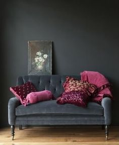 ~ lovely raspberry pillows, tufted settee and deep gray walls