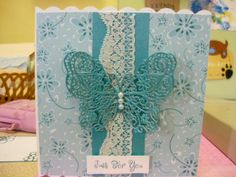 This card is made using background papers from the Tattered Lace magazine and the TL butterfly on pale blue lace and sentiment