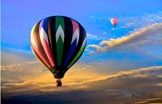 Hot Air Balloons rising into the sky at sunset over Lewiston /Auburn Maine.   Original fine art hot air balloon skyscape photography by Bob Orsillo.  Copyright (c)Bob Orsillo / http://orsillo.com - All Rights Reserved.  Buy art online.  Buy photography online    Great Falls Balloon Festival Lewiston / Auburn Maine