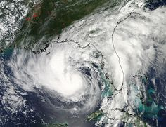 """NASA's Aqua satellite's view of Tropical Storm Isaac on Aug. 27    """"The storm has now strengthened to a hurricane in the Gulf of Mexico."""""""