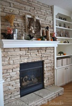 Totally aside from the lovely mantle and autumn home decor, the look of built-in cabinet/bookcase on either side of the fireplace with a crisp matching mantle is wonderful.  In any season, it will be a seasonal decorating focal point!